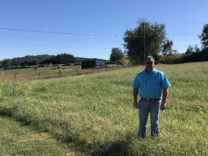 Olen Swisher standing in field